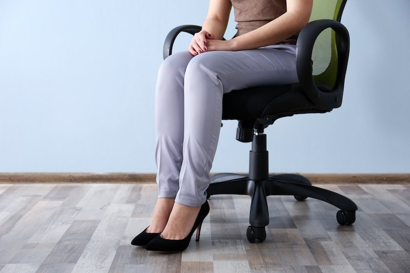 Lady sitting on an ergonomic chair