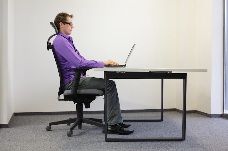 Man using an ergonomic chair to improve posture