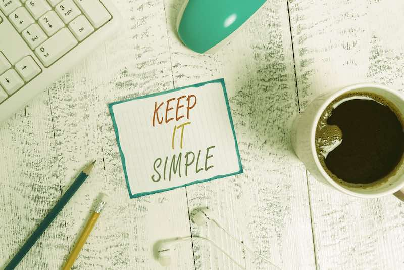 Keep It simple post it sign on an office desk
