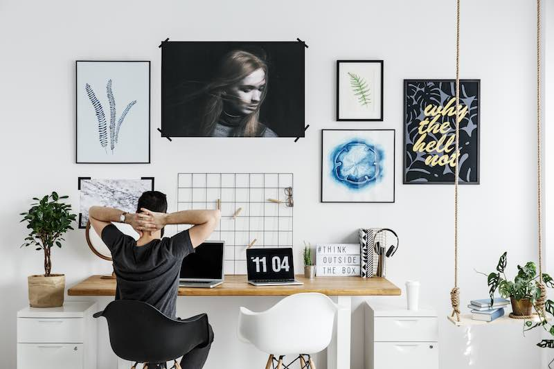 Man working from home at a minimalist office desk