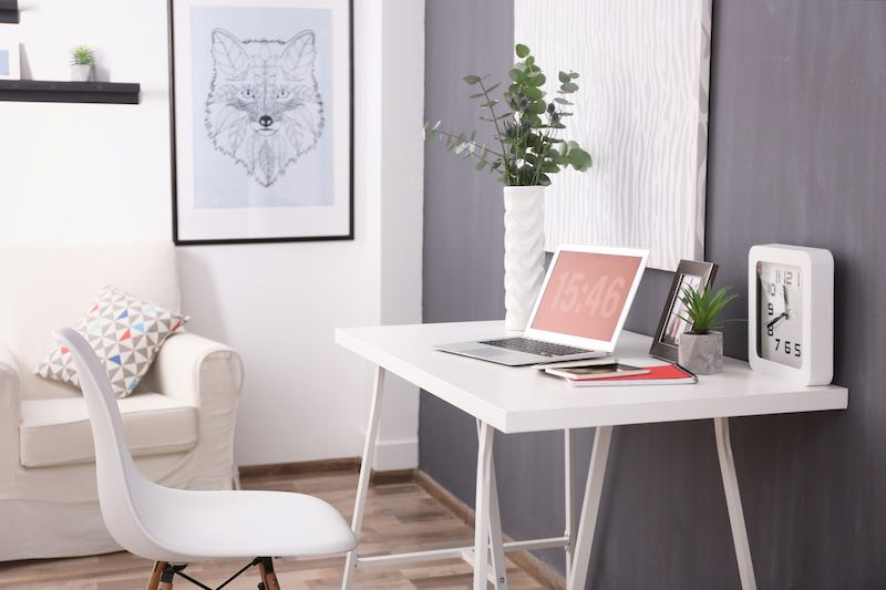 Minimalist office white desk grey walls