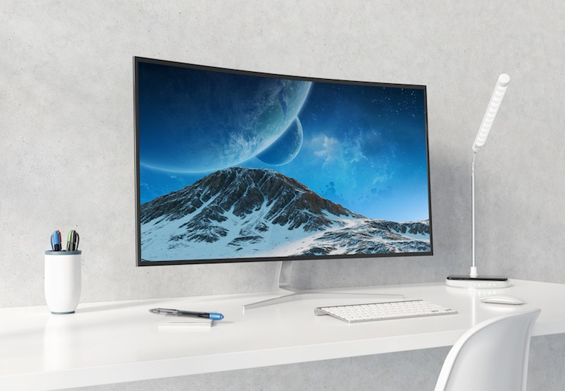 Curved Monitor on a white minimalist office