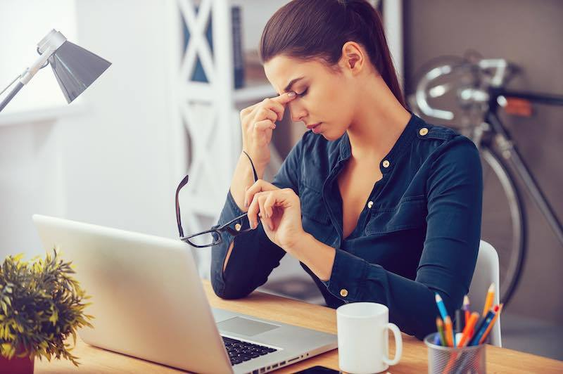 Woman looking for ways to relieve stress at work